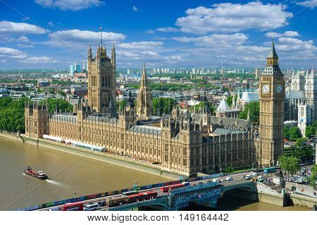 London UK - June 15 2006: Houses of Parliament with Victoria Tower Big Ben and Westminster Bridge in the summer morning London UK