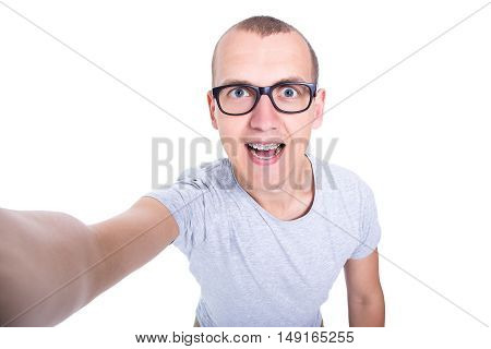 Funny Young Man In Glasses With Braces On Teeth Taking Selfie Photo Isolated On White