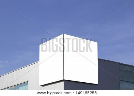Mock up. Outdoor advertising, blank billboard outdoors on the wall of a building blue sky background