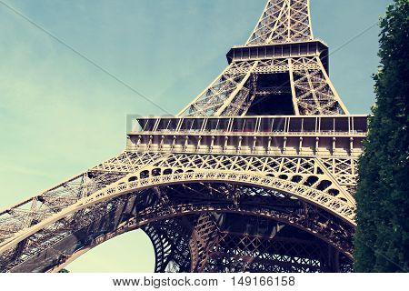 France. Eiffel Tower - the symbol of Paris summer day.