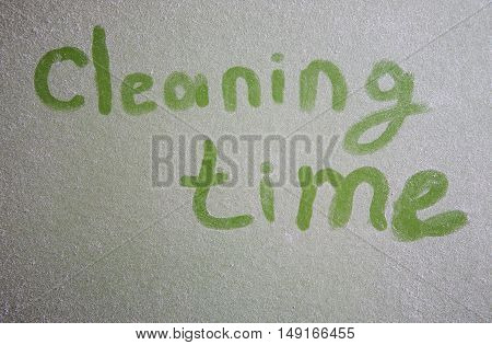 Handwritten Cleaning Time On Dusty Surface