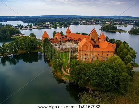Trakai, Lithuania: aerial UAV top view of Island Castle in the sunrise. Historical residence in capital city of Grand Duchy of Lithuania, located in Galve lake