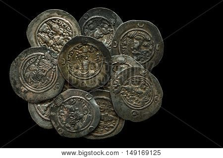 Pile Of Ancient Silver Coins Isolated On Black