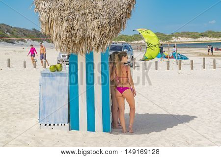 JERICOACOARA, BRAZIL, DECEMBER - 2015 - Attractive young womans with bikinis posing for a photo at Lagoa do Paraiso beach in Jericoacoara Brazil