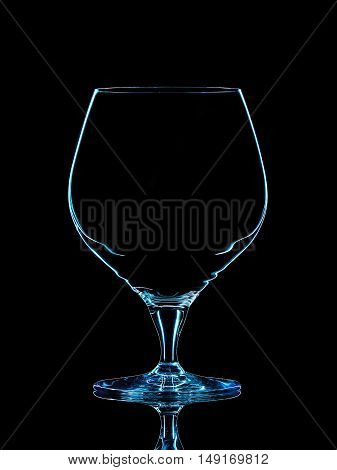 Silhouette of blue whiskey glass with clipping path on black background.