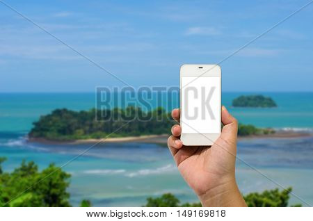 Mobile smart phone behind a of island is beautiful