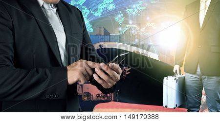 business man connecting on mobile phone and investor people standing against container ship in port and global net work background