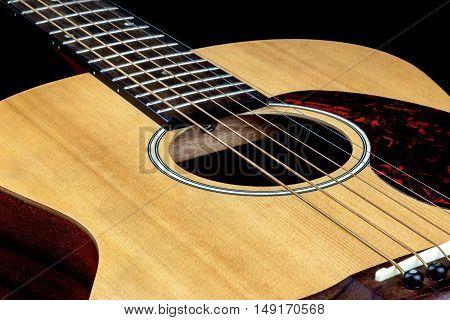 Oblique view of acoustic folk guitar top