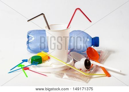 Assorted household plastic waste on white background