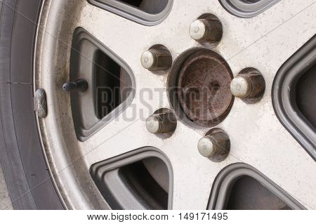 Close up old and rust car wheel with disc brake.