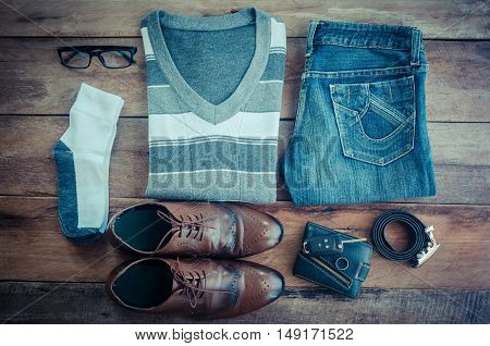 Sweaters jeans socks shoes belts wallets sun glasses ready for travel.