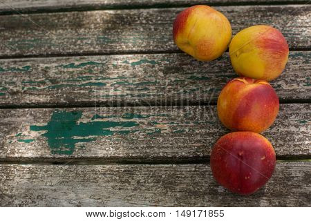 peach on a wooden table, outdoor
