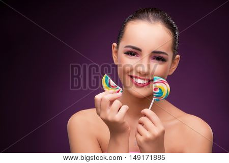 Beautiful woman with colourful lollipop