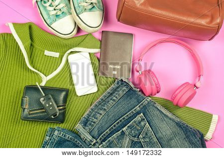 Travel accessories bags shoes hats scarves sun glasses headphones smart phones passports ready for issuing travel vintage tone.
