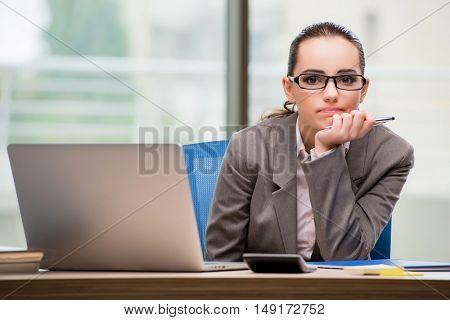 Sad businesswoman working at her desk