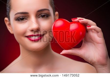 Woman with red heart in romantic concept