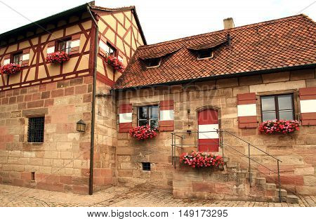 Historic colorful window in a house in Nuremberg, Germany.