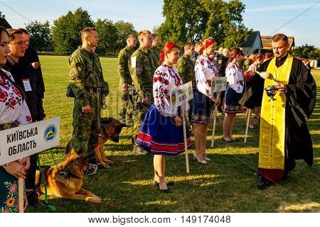 Mukachevo Ukraine - September 27. 2016: The priest blesses the participants of the first National Championship of Ukraine with police dog handlers all-around.