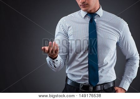 Handsome businessman pressing virtual buttons