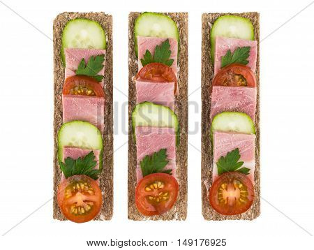 Row Of Crisp Bread With Bacon, Cucumbers And Tomatoes
