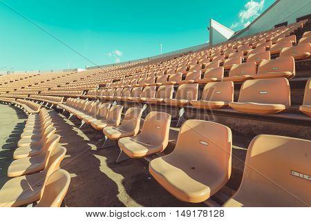 Empty seats at soccer stadium vintage tone