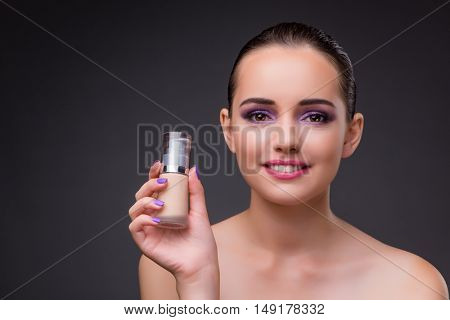 Woman with a bottle of cream