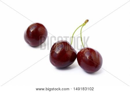 Tasty ripe cherries isolated with white background