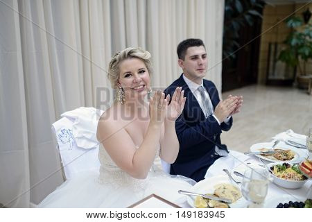 Beautiful Wedding Couple In Restaurant. White Decor For Bride And Groom. Colorful Decoration For Cel