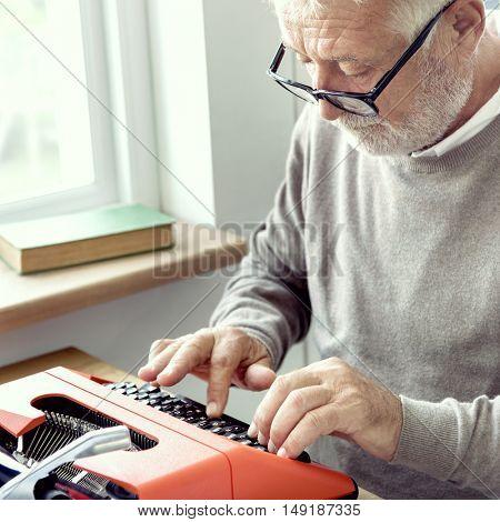 Senior Adult Typing Typewriter Concept
