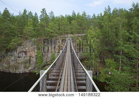 On the suspension bridge Lapinsalmi. Repovesi, Finland