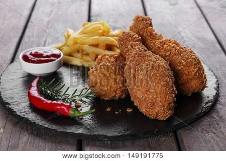 Breaded crispy chicken leg fried french fries sauce
