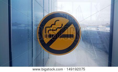 No Smoking Sign on Wet Window. Raining Day