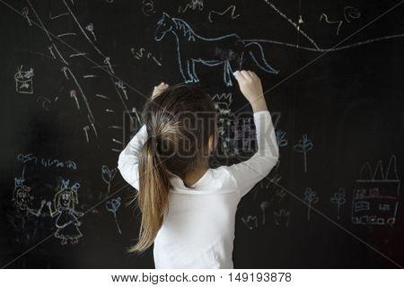 Girl Drawing Blackboard Chalk Concept