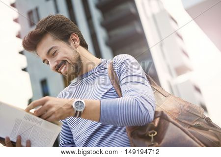 Curious man reading a book