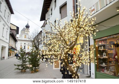 Brunico Italy 14 December 2014: a christmas lights tree decoration outside a shop in the San Candido village