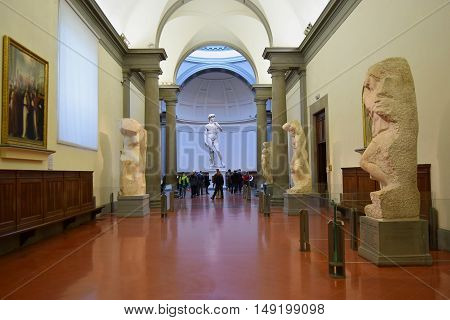 FLORENCE, ITALY - January 20, 2016: a hall by Michelangelo with David and his unfinished works on display at the Accademia Gallery (Galleria dell'Accademia), Florence, Italy