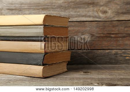 Old Antique Books On Grey Wooden Table