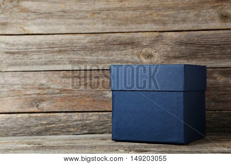 Blue Box On A Grey Wooden Table