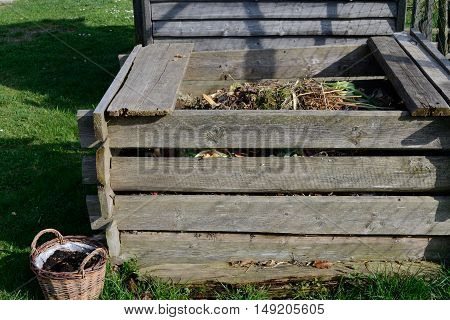 old garden composter made of wood waste