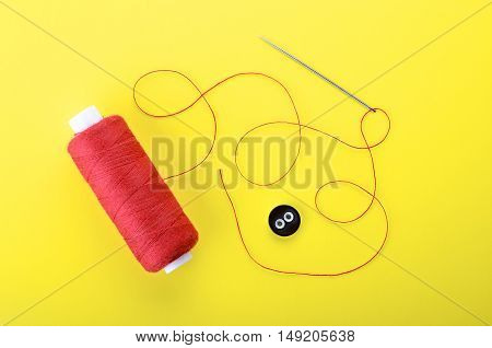 Needle With The Red Thread And Clothing Button