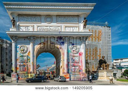 Vandalism on the triumphal arch in Skopje. Skopje, Macedonia - September 24, 2016: Splashes of color on Porta Macedonia, the triumphal arch in the center of Skopje. Color traces after manifestation.