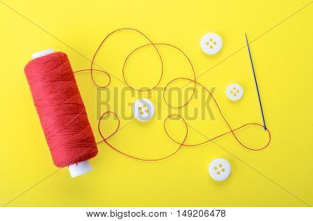 Needle With The Red Thread And Clothing Buttons
