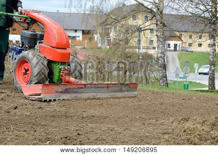 Garden workers leveled with rapping the garden soil