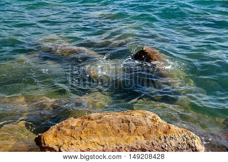 beautiful sea and clear water beach with rocks