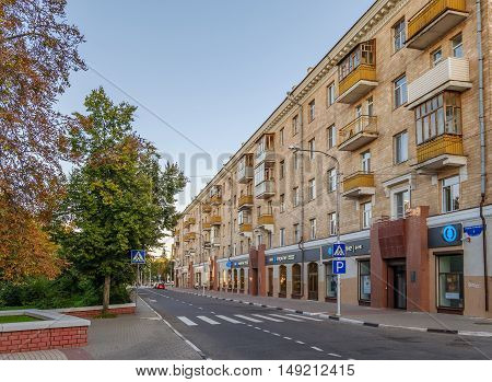 BELGOROD RUSSIA - SEPTEMBER 10 2016: Roadway Holy Trinity Boulevard in the center of Belgorod. Residential house in late Stalin era (mid 20th century).