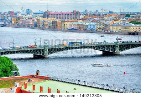 ST PETERSBURG RUSSIA-JUNE 19 2015. Panorama of historical center of Saint Petersburg and Trinity bridge over Neva river- birds eye view. Architecture landscape of St Petersburg Russia in cloudy day