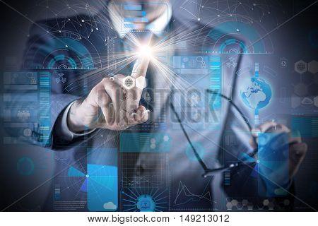 Businessman pressing buttons in futuristic concept