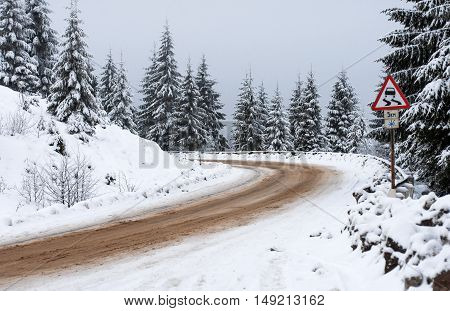 a winter road goes away to the mountains down grade