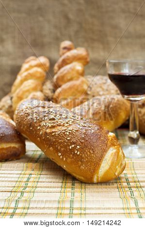 Still life assortment of bread with a glass of red wine. Selective focus with shallow depth of field.