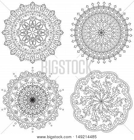Vector set of four decorative elements mandala in black and white. For coloring pages backgrounds decoration for your design.